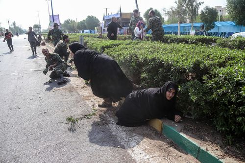 State television said the assault, which wounded more than 60 people, targeted a stand where Iranian officials had gathered in the city of Ahvaz to watch an annual event.