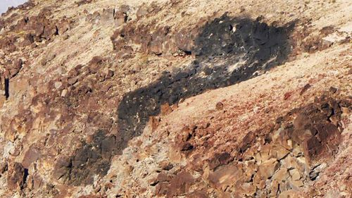 A scorch mark on the ground following a jet crash in Death Valley.