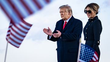 President Donald Trump and First Lady Melania Trump on stage after speaking to supporters at Joint Base Andrews, before boarding Air Force One for his last time as President on January 20, 2021.