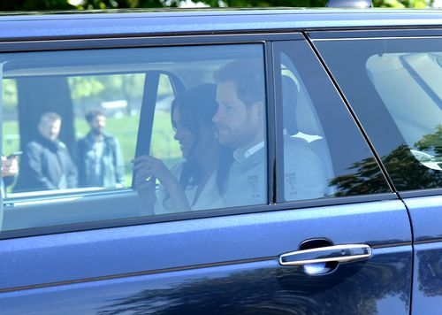 Meghan Markle looks happy and Prince Harry a little nervous as they drive up to Windsor Castle. Picture: Getty