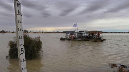 The Copper Creek ferry in operation for the first time in 20 years on the Birdsville Track near the town of Marree in South Australia, Sunday, July 4, 2010