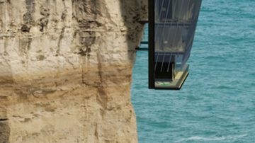 """The """"Cliff House"""" clings to the side of the cliff using high-tech metal pins. (Supplied, Modscape)"""