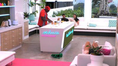 Taku tries to woo Jess over with a fruit platter on Love Island Australia 2021.