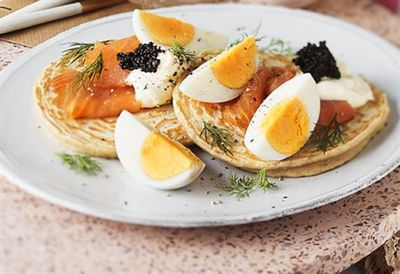 Blinis with hard boiled egg and smoked salmon