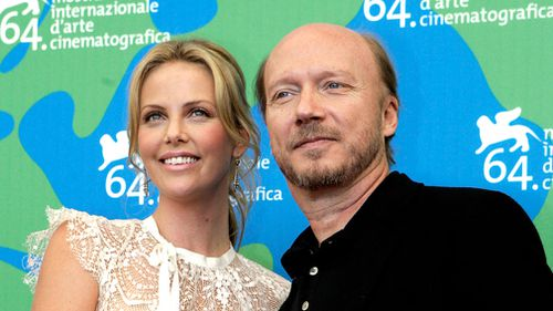 "Actress Charlize Theron and director Paul Haggis pose during the photocall of their movie ""In the Valley of Elah"" in September, 2007. (AAP)"