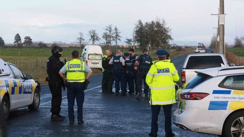 Police surround the site where the campervan was abandoned.