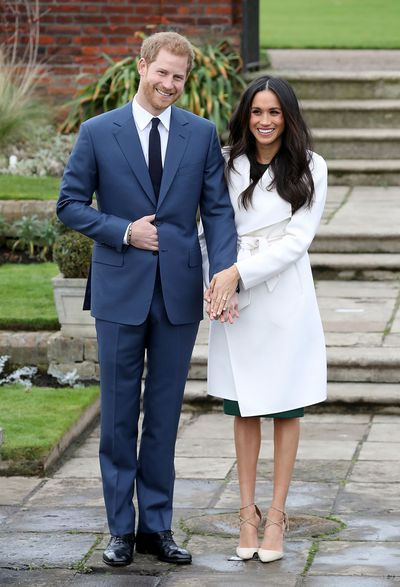 Meghan Markle and Prince Harry during an official photo call to announce their engagement at The Sunken Gardens at Kensington Palace on November 27, 2017