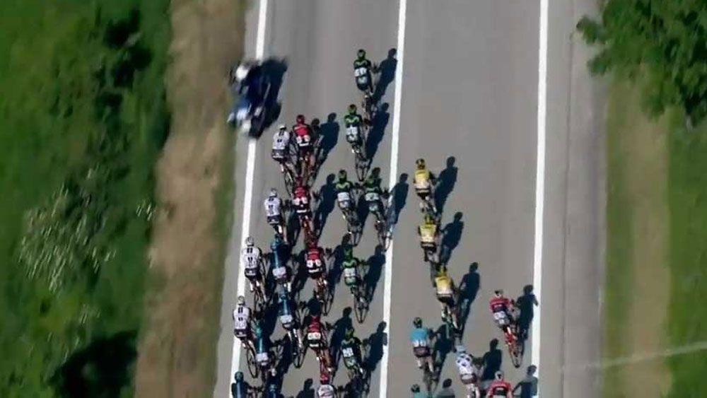 Police motorbike causes huge crash in stage nine of Giro d'Italia