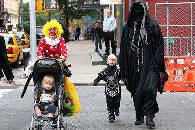 Naomi Watts (left) and Liev Schreiber (right), win the prize for freakiest family costumes at Halloween. Here Alexander, dressed as a mini-Grim Reaper, trick or treats through New York City.