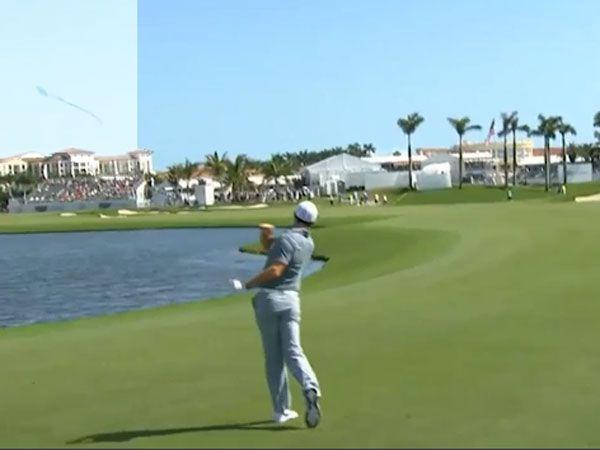 McIlroy hurls golf club into lake