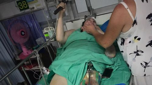 Ms Liddle's mother, Leanne, assists her during an emotional moment in hospital. (Supplied)