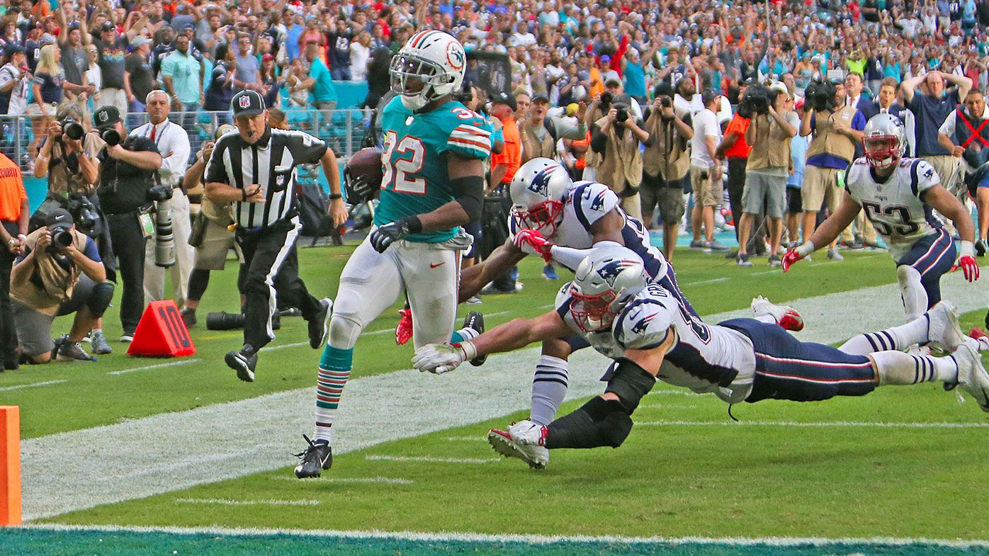 6aa78da06 Miami Dolphins score unbelievable walk-off touchdown after time expires to  defeat New England Patriots
