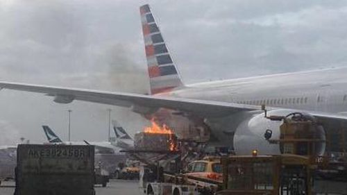 Cargo catches fire as it's loaded into an American Airlines plane in Hong Kong. (Twitter)