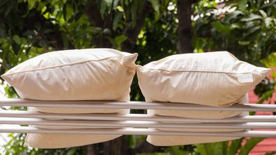 Pillows drying outside on a washing line