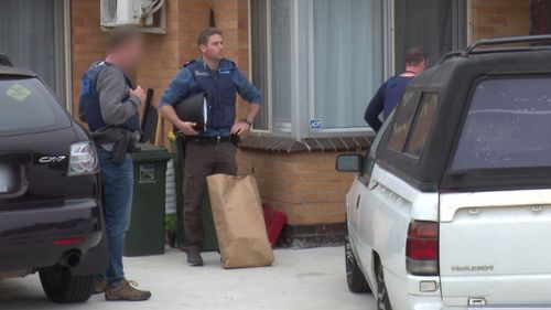 Officers were snapped taking evidence from the scene. (Victoria Police)