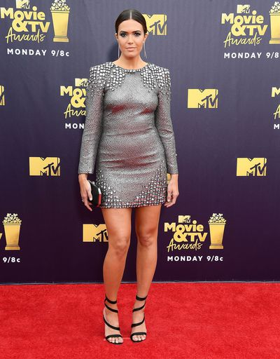 "<p>The stars have brought their sartorial A-game to the 2018 MTV Movie and TV Awards red carpet in Los Angeles.</p> <p>Turning heads like only <a href=""https://style.nine.com.au/2018/06/14/13/57/kim-kardashian-blue-hair-yeezy-hair"" target=""_blank"" draggable=""false"">Kim Kardashian-West</a> can, the beauty mogul, who brought her mum Kris Jenner along for a girls night out, rocked cornrows and a white bandeau top&nbsp;with a curve-hugging, silver skirt with a thigh-high slit by Versace.</p> <p>But Kardashian-West wasn't the only A-lister who stood out on the red carpet. <br /> <br /> <a href=""https://style.nine.com.au/2017/09/14/14/39/style_mandy-moore-hair-comeback"" target=""_blank"" draggable=""false"">Mandy Moore</a> channelled her inner JLo in a metallic mini dress by Alberta Ferretti, while Zendaya wowed in a structured mini dress with an&nbsp;exaggerated skirt by&nbsp;August Getty Atelier, and actress Olivia Munn put her sartorial stamp on a plunging emerald green velvet jumpsuit by Galvan London.</p> <p>Click through to take a look at the most-talked about looks of the night.</p>"