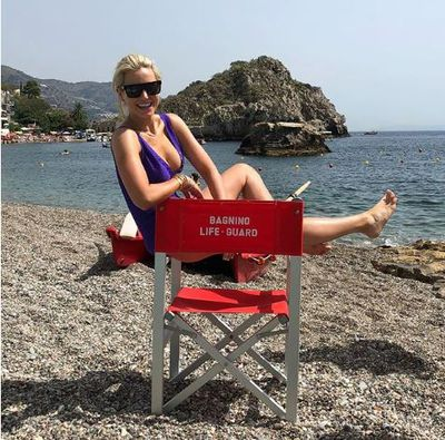 Roxy Jacenko in a purple one-piece swimsuit from Eres Paris in Taormina, Sicily