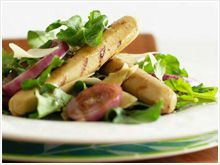 Lime and ginger sausages with rocket and parmesan