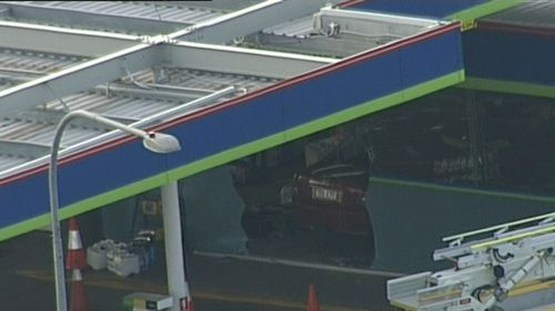 Three people have been injured after a car slammed into  Freedom Fuels in Brisbane. Picture: 9NEWS