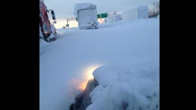Hundreds of cars were abandoned on the Interstate 90 after the snow storm trapped drivers and passengers. (@PhilCiallela - Twitter)