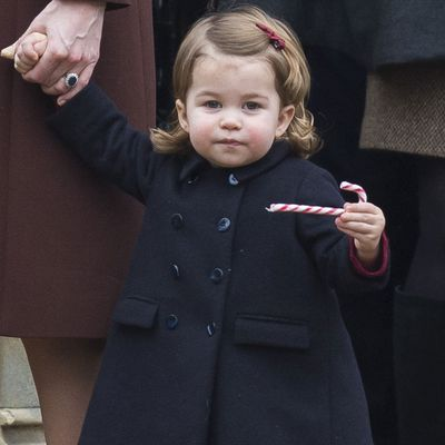Princess Charlotte enjoys a candy cane at Christmas Mass, December 2016
