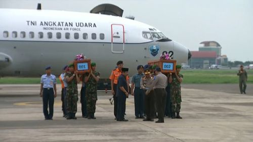 The first two coffins containing victims' bodies from AirAsia flight QZ8501 have arrived at Lanudal Airbase in Surabaya. (BSkyB)