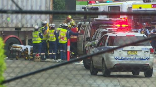 Emergency services called to the workplace on Helles Avenue in Moorebank found the man dead at the scene and another injured passenger.