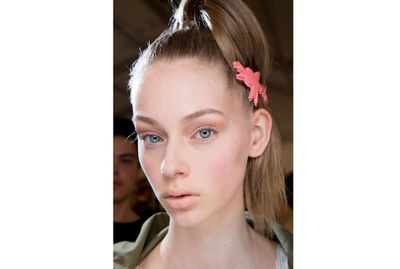 <p>Need to keep your pony in place? Make like the models at Prada Fall 2015 and use your prettiest pin to stop hair blowing in the wind.</p>
