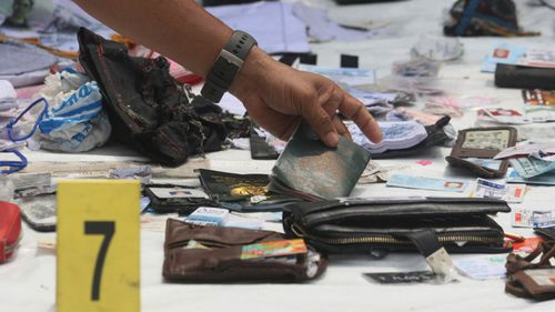 Passports and wallets are among the debris collected following the crash.