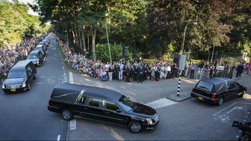 Each of the bodies was assigned its own hearse for the drive through the city. (Getty Images)