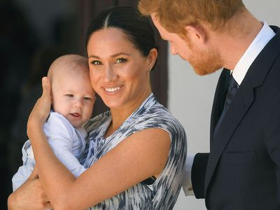 Meghan cuddles up to Archie on her and Harry's Africa tour, September 2019