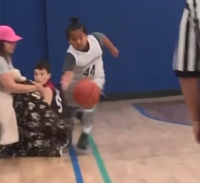 Mum tries to trip 9-year-old playing basketball against her son