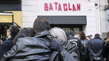 Mourners gather outside the Bataclan concert hall in Paris on the anniversary of the terrorist attack.
