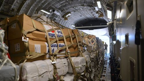 The first Australian aid relief delivery heads for cyclone-devastated Vanuatu. (AAP)