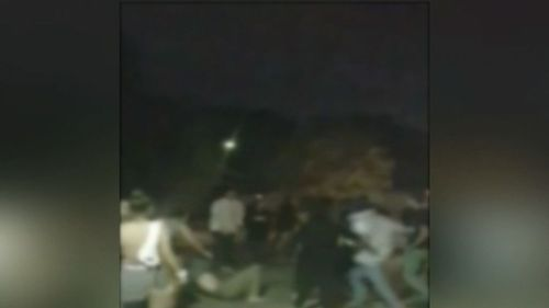 A number of people are seen being knocked to the ground in the violence. (9NEWS)