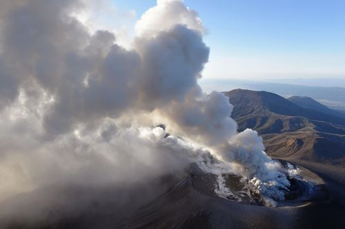 A column of volcanic smoke rises from the crater on the Shinmoedake volcano, (AP)
