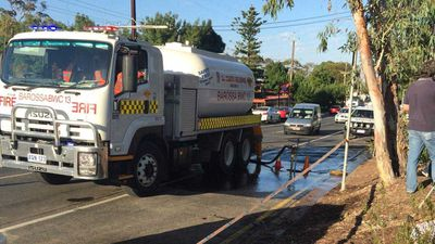 A water tanker fills up again before heading back out to the fire front. (Twitter)