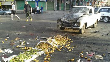 The aftermath of a bomb in the city of Sweida. (AAP)