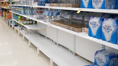 Empty shelves where boxes of water would normally be, in Coles Supermarket, Woy Woy.