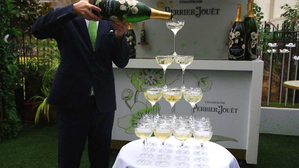 Chris Sheehy tops off our Champagne tower. Video/Image: 9Kitchen