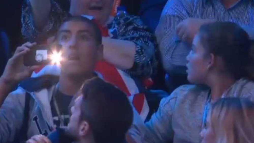 Tennis: Oblivious fan shines a light on Djokovic