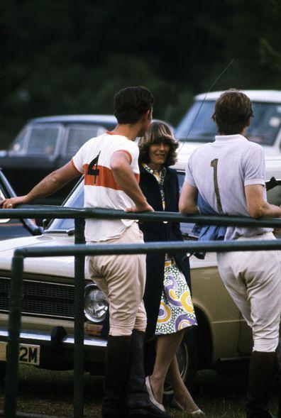 Prince Charles chats to Camilla Parker-Bowles at a polo match.