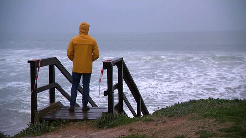 A person looks out to sea at Collaroy beach, in Sydney's north.