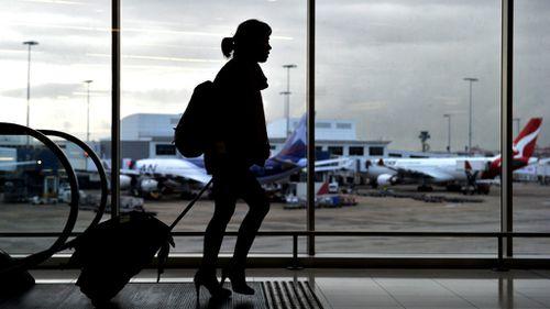 A passenger walks through the international terminal at Sydney Airport. (AAP stock)