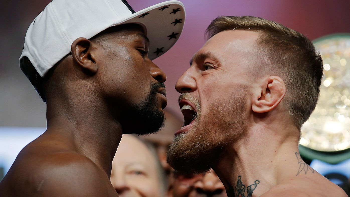 Floyd Mayweather Jr and Conor McGregor face off
