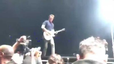 Queens of the Stone Age's Josh Homme kicks female photographer in the head, cuts himself