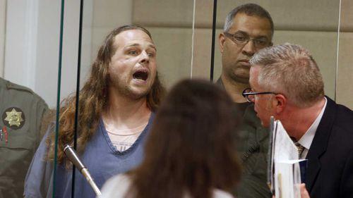 US murder suspect yells about free speech