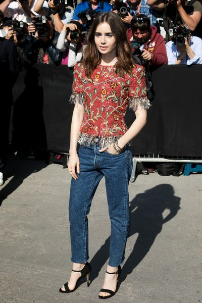 Actress Lily Collins dressed up her jeans with an embellished Chanel top at the Chanel haute couture show, Paris.