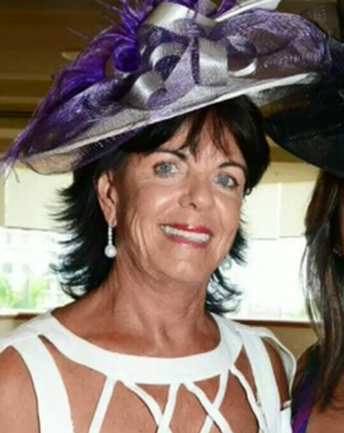 Gai Vieira is clinging to life after a police car ploughed into her vehicle.