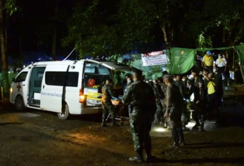 Rescue crews load one of the boys into the back of a van before he is taken to Chiang Rai Hospital. Picture: AAP